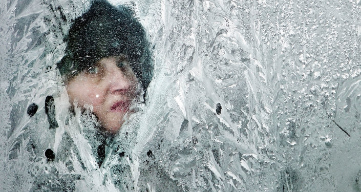 A woman looks out of a window covered in frost on a bus in Bucharest, Romania, in February 2012. At least 11,000 villagers have been trapped by heavy snow and blizzards in Serbia's mountains, authorities said Thursday, as the death toll from Eastern Europe's weeklong deep freeze rose to 122, many of them homeless people.