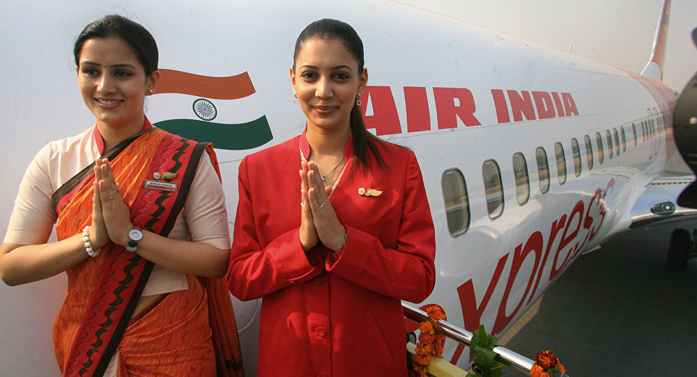 Air India air hostesses wearing their new uniform pose for photographers during the delivery of a Boeing 737-800 Commercial Jetliner for Air India in New Delhi. (File)