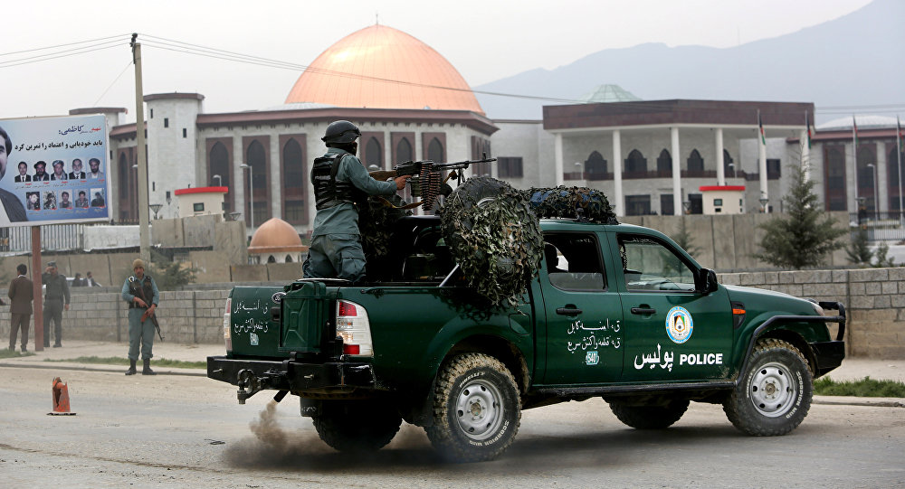 Afghan policemen stand alert in front of the new parliament building after a rocket attack in Kabul, Afghanistan (File)