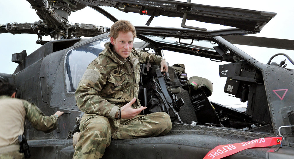 Britain's Prince Harry or just plain Captain Wales talks to a TV crew