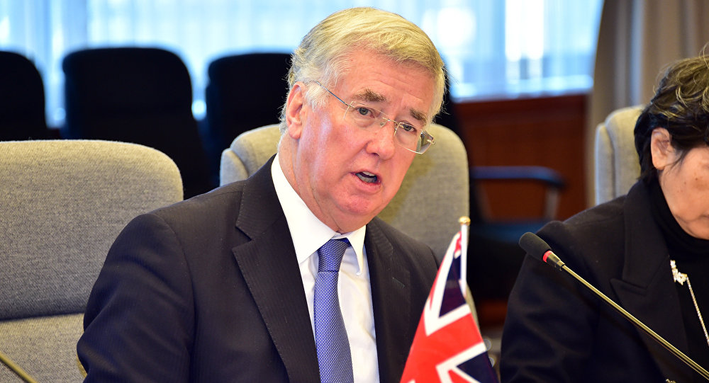 British Defence Secretary Michael Fallon talks with his Japanese counterpart Gen Nakatani at the defence ministry in Tokyo on January 9, 2016