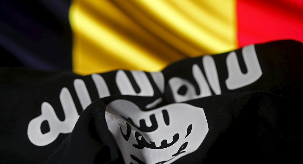 Islamic State flag is seen in front of a Belgian flag in this illustration taken March 22, 2016