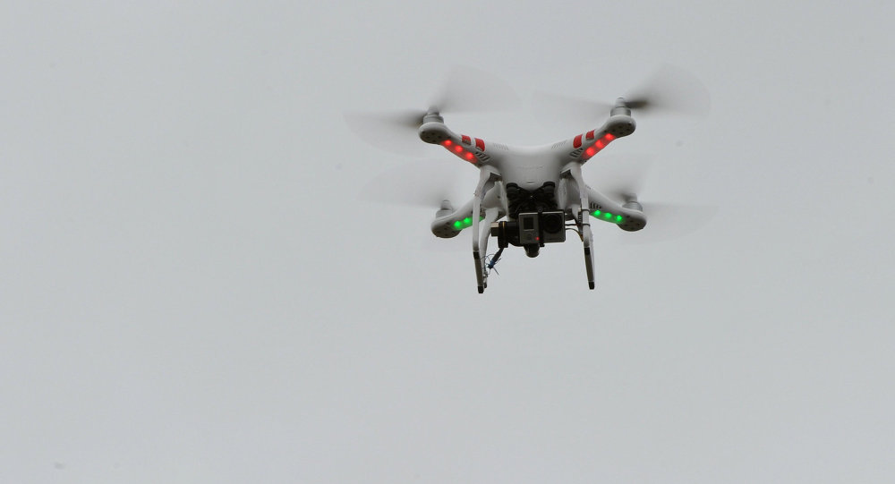A four-engined unmanned aerial vehicle hovers over State Mutual Stadium