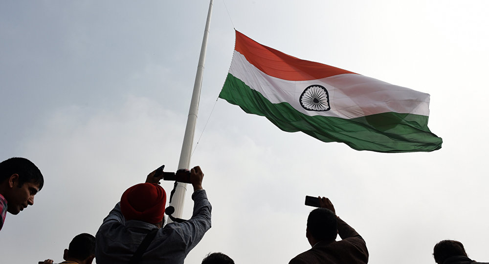 Indian residents photograph India's tallest flag as it is unveiled in Faridabad on the outskirts of New Delhi on March 3, 2015