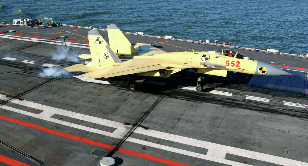 In this undated photo released by China's Xinhua News Agency, a carrier-borne J-15 fighter jet lands on China's first aircraft carrier, the Liaoning
