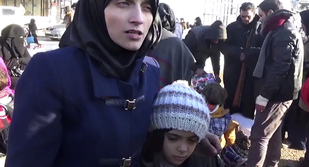 Fatemah Alabed, with her 7-year-old daughter Bana, speaking after they reached the Aleppo countryside following the evacuation of their city, Syria. (File)