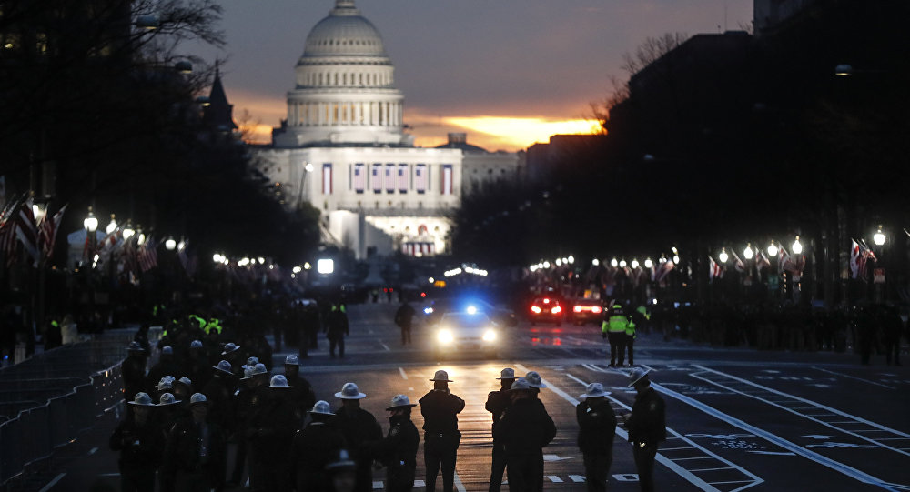 Security personnel gather on Pennsylvania Avenue before the presidential inauguration of President-elect Donald Trump, Friday, Jan. 20, 2017, in Washington