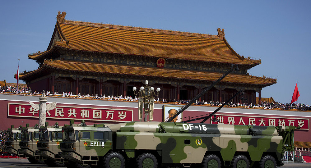 In this Sept. 3, 2015 photo, military vehicles carry DF-16 short-range ballistic missiles past Tiananmen Gate during a military parade to commemorate the 70th anniversary of the end of World War II in Beijing. A highly accurate Chinese ballistic missile capable of threatening U.S. and Japanese bases in Asia has made its latest appearance at recent Rocket Force drills. The medium-range DF-16 featured in a video posted on the Defense Ministry's website showing the missiles aboard their 10-wheeled mobile launch vehicles being deployed in deep forest during exercises over the just-concluded Lunar New Year holiday.