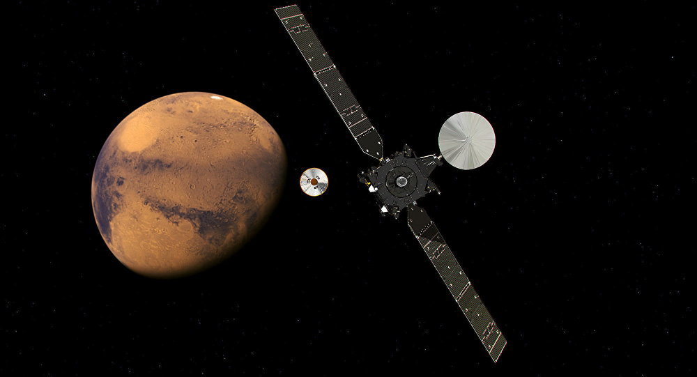 The ExoMars Trace Gas Orbiter and its entry, descent and landing demonstrator module, Schiaparelli, approaching Mars.