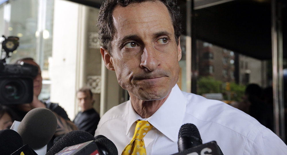 In this July 24, 2013 file photo, New York City mayoral candidate Anthony Weiner leaves his apartment building in New York