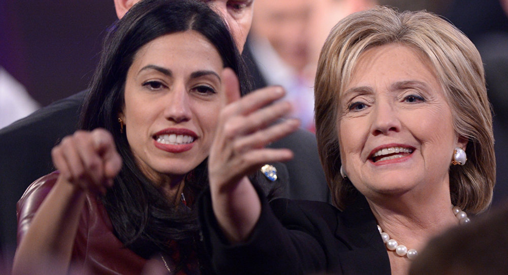 Democratic Presidential hopeful Hillary Clinton (R) gestures next to Huma Abedin