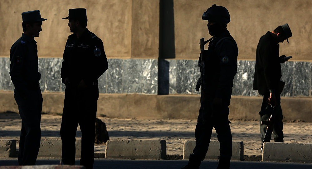 In this Saturday, Feb. 27, 2016 file photo, Afghan National police stand at the site of a suicide attack near the Defense Ministry compound, in Kabul, Afghanistan.
