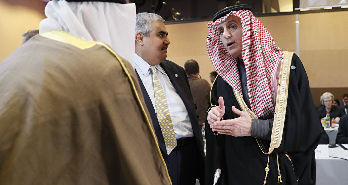 Saudi Foreign Minister Adel al-Jubeir (R) speaks as the Bahraini Foreign Minister Khalid bin Ahmed al-Khalifa (C) listens on at the opening of the Mideast peace conference in Paris on January 15, 2017.