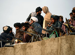 In this photograph taken on November 3, 2015, Afghan Taliban fighters listen to Mullah Mohammad Rasool Akhund (unseen), the newly appointed leader of a breakaway faction of the Taliban, at Bakwah in the western province of Farah