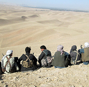 In this photo taken on Thursday, Oct. 1, 2015, Afghan security forces and volunteer militias stage on their way to Kunduz, Afghanistan to fight against Taliban fighters