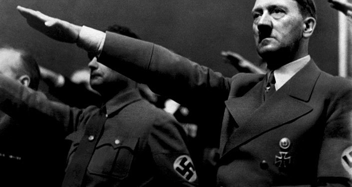 A picture dated 1939 shows German Nazi Chancellor Adolf Hitler giving the nazi salute during a rally next to Deputy Furhrer Rudolf Hess.