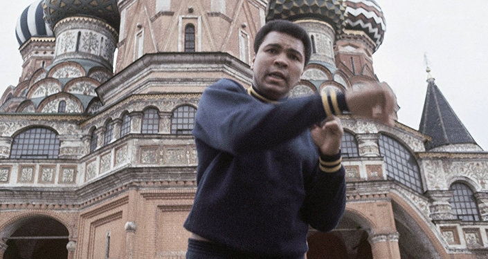 Boxer Muhammad Ali doing his roadwork past St. Basil's and Lenin's mausoleum in Moscow in June 1978
