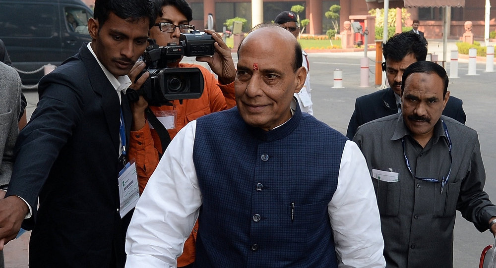 Indian Home Minister Rajnath Singh arrives for the start of the winter session of Parliament in New Delhi on November 24, 2014