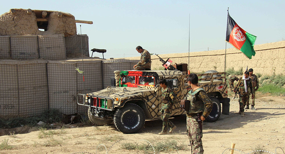 Afghan National Army (ANA) soldiers stand next to an outpost where 12 soldiers were killed by their comrades in the northern city of Kunduz, Afghanistan September 27, 2016