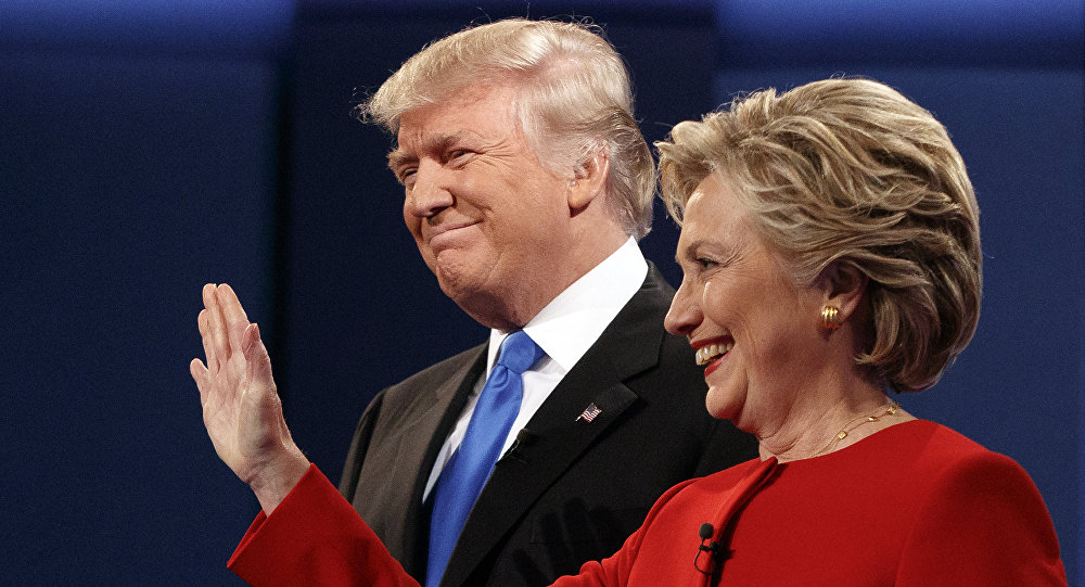 Republican presidential candidate Donald Trump, left, stands with Democratic presidential candidate Hillary Clinton at the first presidential debate at Hofstra University, Monday, Sept. 26, 2016, in Hempstead, N.Y.