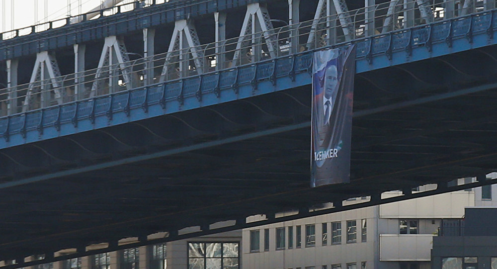 A banner with an image of Russian President Vladimir Putin hangs from the Manhattan Bridge in New York