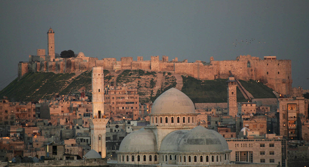 A picture taken 17 March 2006 shows a general view of the historic Syrian city of Aleppo, 350 kms north of Damascus, with its landmark cytadel in the background.