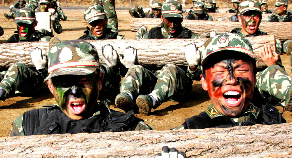 In this photo released by China's Xinhua News Agency, fresh men of the special police train the strength of their muscles during a one-week drilling in Beijing (File)