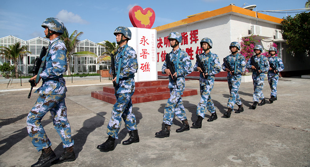Soldiers of China's People's Liberation Army (PLA) Navy patrol at Fiery Cross Reef, in the Spratly Islands, known in China as the Nansha Islands (File)